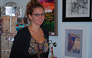 Artist Kelly Campbell with some of her art during the Artwalk